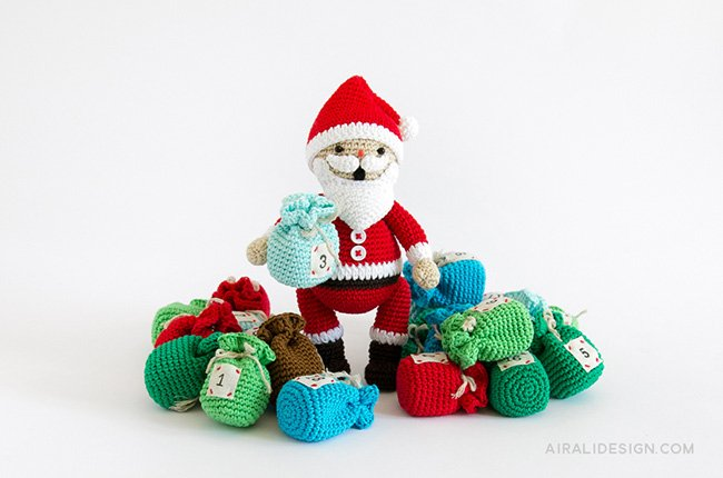 Santa Claus with Christmas stockings and sacks crochet pattern in Amigurumi Winter Wonderland book by Ilaria Caliri