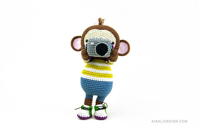 Monkey with photo camera. Crochet pattern from the book Amigurumi Globetrotters by Ilaria Caliri