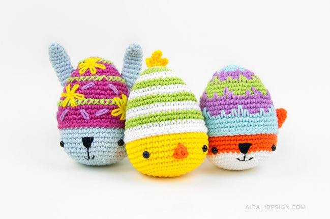 Amigurumi eggs decorated like a bunny, chick and fox, crochet pattern by Airali design