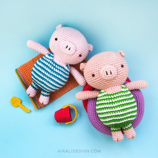 Amigurumi pig on holiday with striped swimsuit, life-ring, bucket and spade, crochet pattern by Airali design