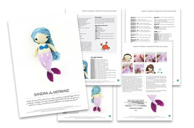 Sandra the amigurumi mermaid with blue hair and pink fin, crochet pattern by Airali design