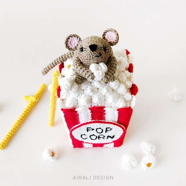 Steno the stiltwalker amigurumi mouse with the popcorn box, crochet pattern by Airali design